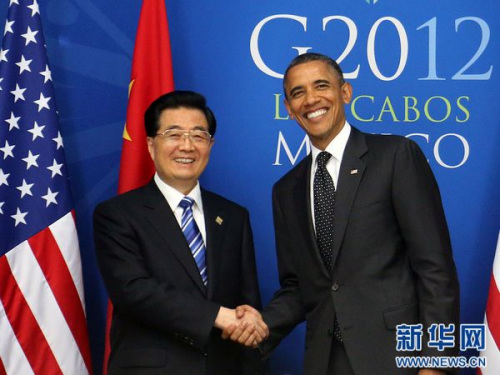 6月19日,中国国家主席胡锦涛在墨西哥洛斯卡沃斯会面美国总统奥巴马。 新华社记者 兰红光 摄