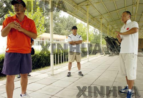 材料图:杨昌勋在领导国家队员 图像来历:新华社