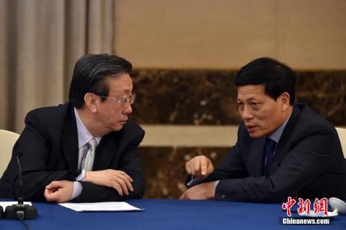 資料圖:郭庚茂(左)與謝伏瞻(右)。