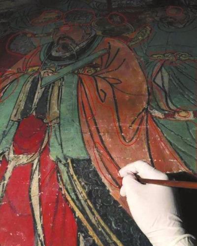 网友质疑女壁画师微博展示的修复图片存在修复问题。 网络截图
