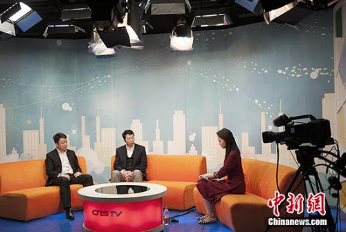 联合电动联合创始人兼CEO曹刚与联合电动销售副总裁徐晓龙在接受专访。