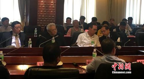 足改两周年座谈会现场,从左至右,李毓毅、年维泗、蔡振华、张剑。记者王牧青摄