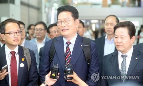 韩国总统特使宋永吉启程访俄。图片来源:韩联社