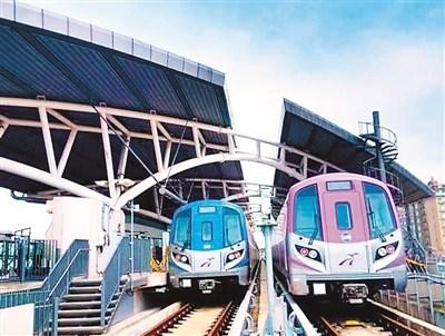 桃园机场捷运,蓝色为普通车,紫色为直达车。(资料图片)