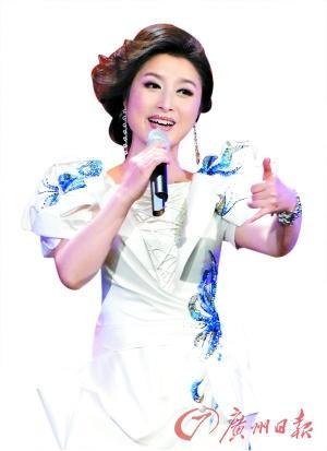 刘媛媛:和成龙合唱《国家》声线反差不大(图)