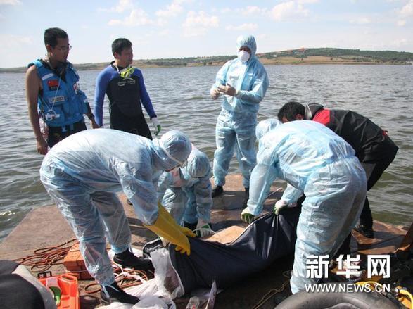 沈阳坠机事件美籍飞行员遗体在当地火化(图)