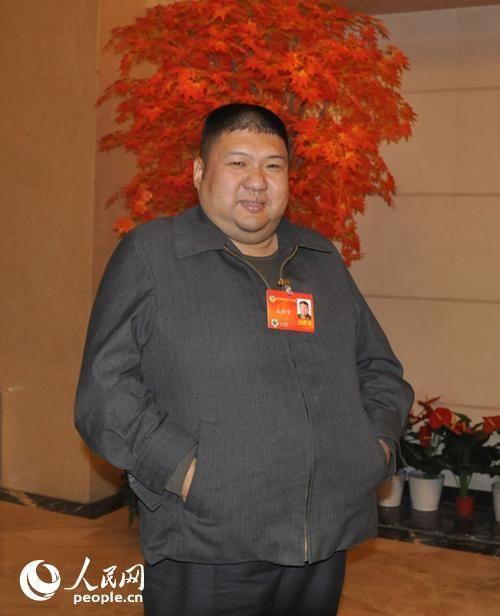 全国政协委员、军事科学院军事战略研究部副部长毛新宇。(记者赵晶 摄)