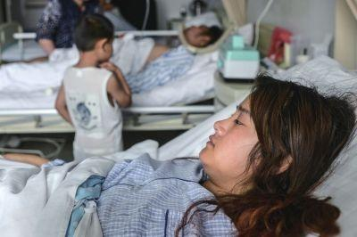今天,一家三口在307病院承受医治。京华时报记者王苡萱摄