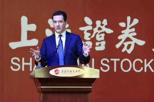 9yue 22日,奥斯本参观上海证交所并发表讲话.(路透社)