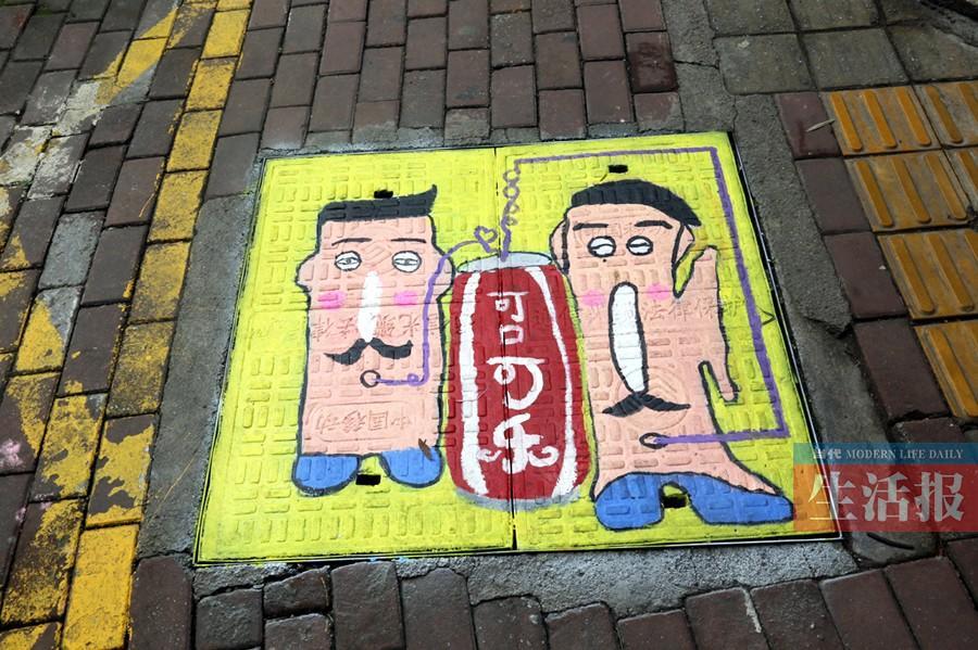 南宁新竹路涂鸦井盖引围观 涂鸦虽萌或致视觉障碍