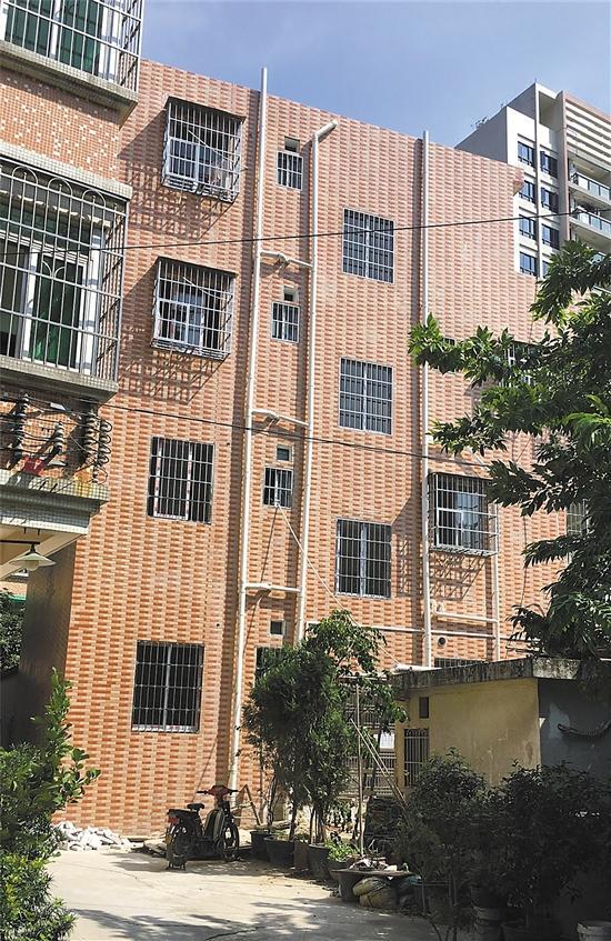 广州1栋4层违建拆不动 城管决定强拆无法落实(图)