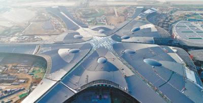 北京新机场主航站楼封顶封围(组图)韩剧让爱留在心底