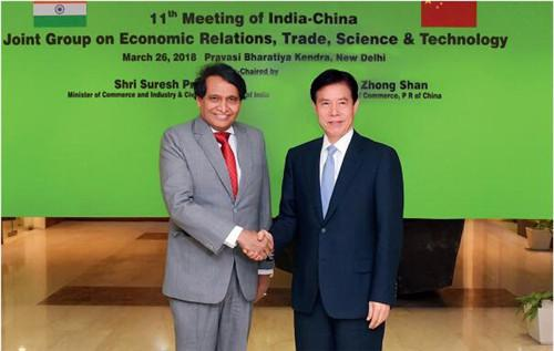 26 3月26日,中国商务部部长钟山和印度商工部部长普拉布在印度新德里共同主持召开中印经贸联合小组第11次会议。