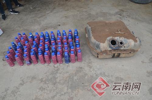 饮料瓶内装冰毒暗藏油箱 云南勐腊警方缴毒超30公斤清远职业技术学院素拓