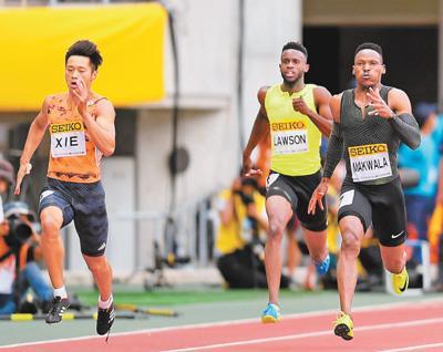 男子200米跑出20秒16 中国选手谢震业刷新全国纪录