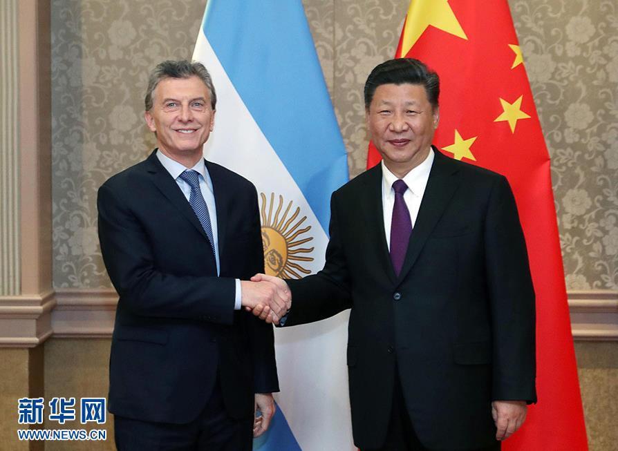 7月26日,国家主席习近平在南非约翰内斯堡会见阿根廷总统马克里。 新华社记者 刘卫兵 摄