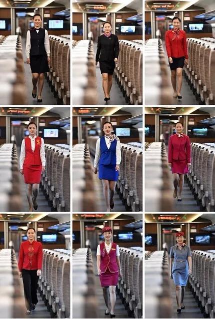 """7月18日,在京津城际列车上,从左至右""""动姐""""们正依次展示第一至第九套京津城际列车乘务员制服。新华社记者 李然 摄"""