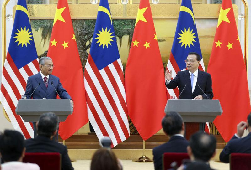 李克强与马来西亚总理马哈蒂尔共同会见记者