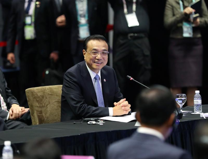 李克强新加坡之行:以自贸区升级维护多