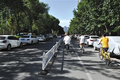 5月31日,广战里中街,内侧灵活车讲战非灵活车讲停谦了灵活车。