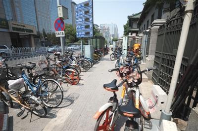 """北京东西城区共享单车""""入栏结算""""共享单车根治乱停放需找平衡点"""