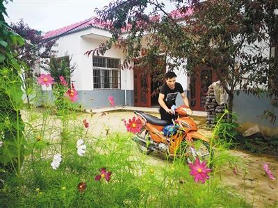 狮峰村演绎扶贫路上的幸福三重奏