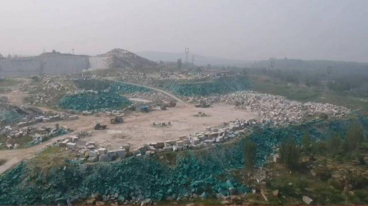 应付环保检查、蒙蔽卫星监测 山东一矿山被涂上绿漆