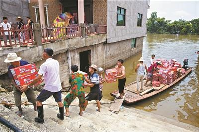 洪水淹了房屋 淹不了心中的希望