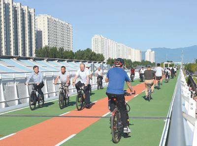 著力改造提升慢行系統 新建專用道,壓減停車位