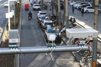 北京停车计费拟出新招 管理员可边骑边拍