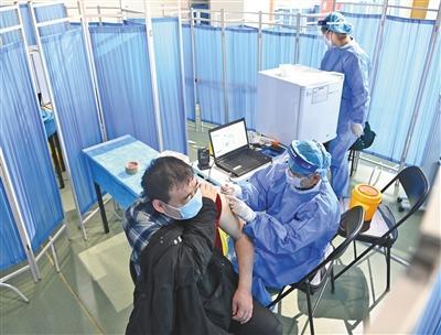 春节期间,北京多区持续开展新冠疫苗接种工作