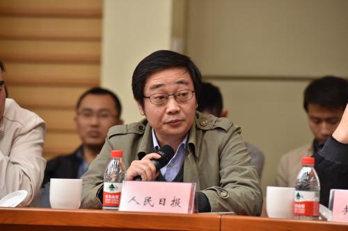 人民日报社新闻协调部副主任 丁伟