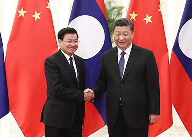 习大大会见老挝总理通伦