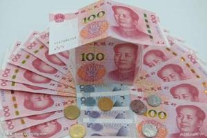 人民币对美元汇率中间价报6.7659元 下调36个基点