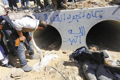 卡扎菲逃亡60天后命丧故乡辗转期间仍发表演讲