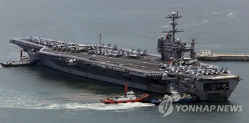 韩美日举行联合海上演习朝鲜强烈谴责(图)