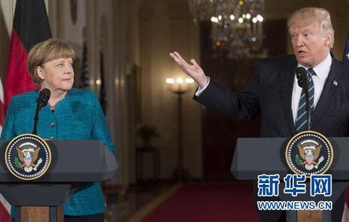 """特朗普与默克尔首次会面""""不合拍""""难掩分歧"""