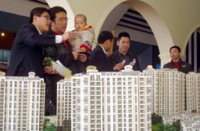 南华早报:央行降息了 此时买房还是卖房?-中新