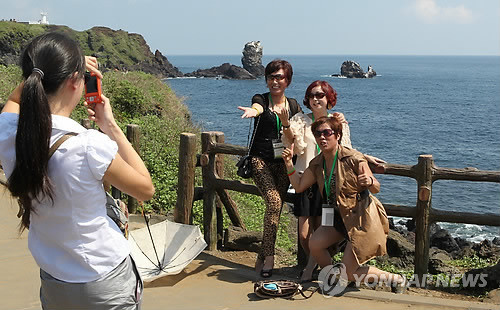 访韩国济州岛中国游客剧增 旅游收入水涨船高