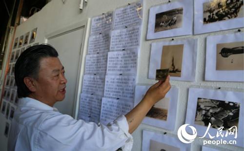 """中国侨网由日本随军记者拍摄的""""百万日军登陆杭州湾""""的海陆空景况照片尤为引人注意。(人民网/韩莎莎 摄)"""