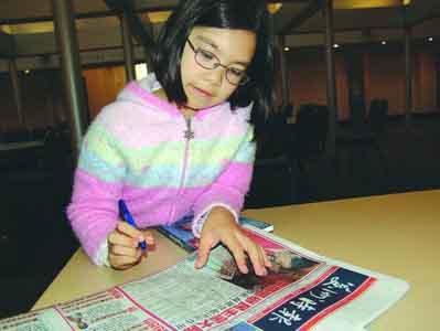 酷爱读书写作的9岁小作家邹奇奇.(美国《美洲时报》图)图片