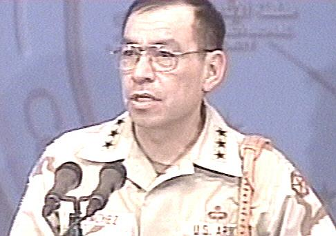 布雷默和驻伊美军司令在记者招待会上