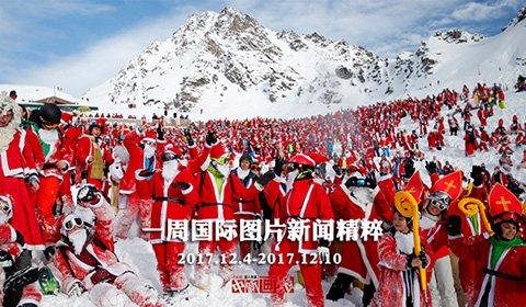 12月2日,众多民众身穿圣诞老人服装,在瑞士韦尔比耶进行高山滑雪。
