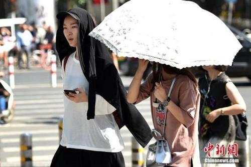 北京高温黄色预警信号持续今日最高38℃