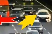 高速公路爆胎抛锚 女司机穿梭车流打电话