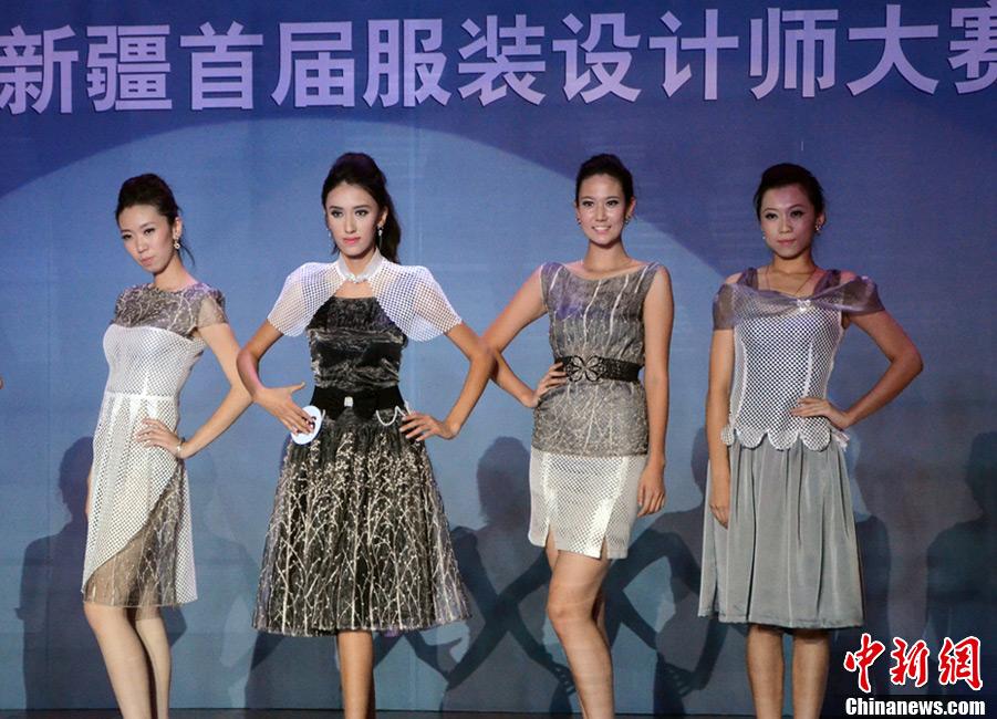 新疆举办首届服装设计师大赛 演绎民族时尚 (11/12)