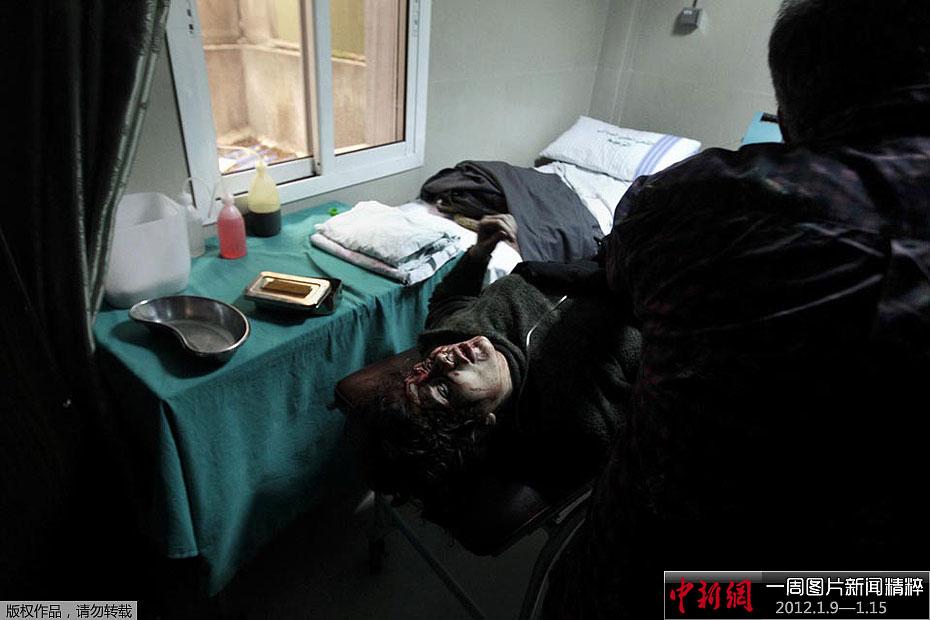 摄影记者在该市动乱中丧生,成为叙利亚抗议活动10个月来首名高清图片