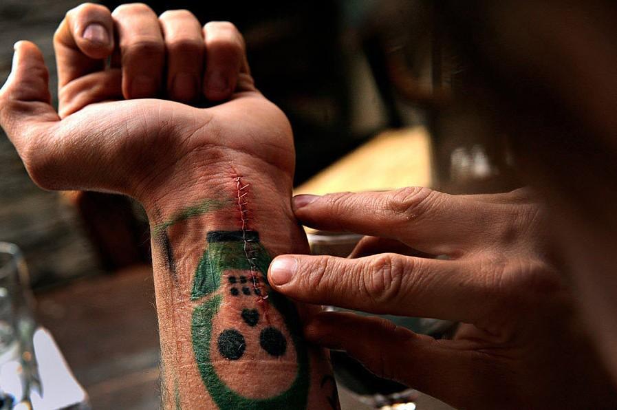 第96届普利策奖特写摄影奖――伊战士兵Scott Ostrom