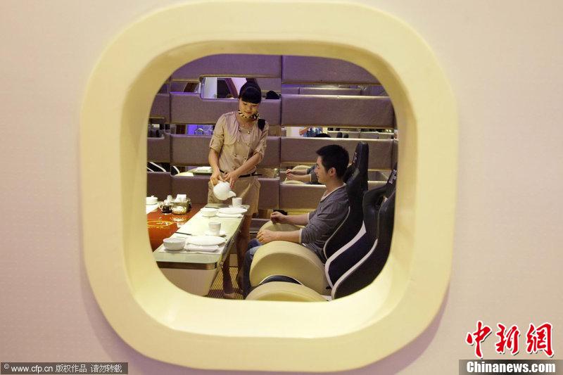 """... 一餐厅装潢仿空客A380 吃饭也坐""""特等舱""""-中新网"""