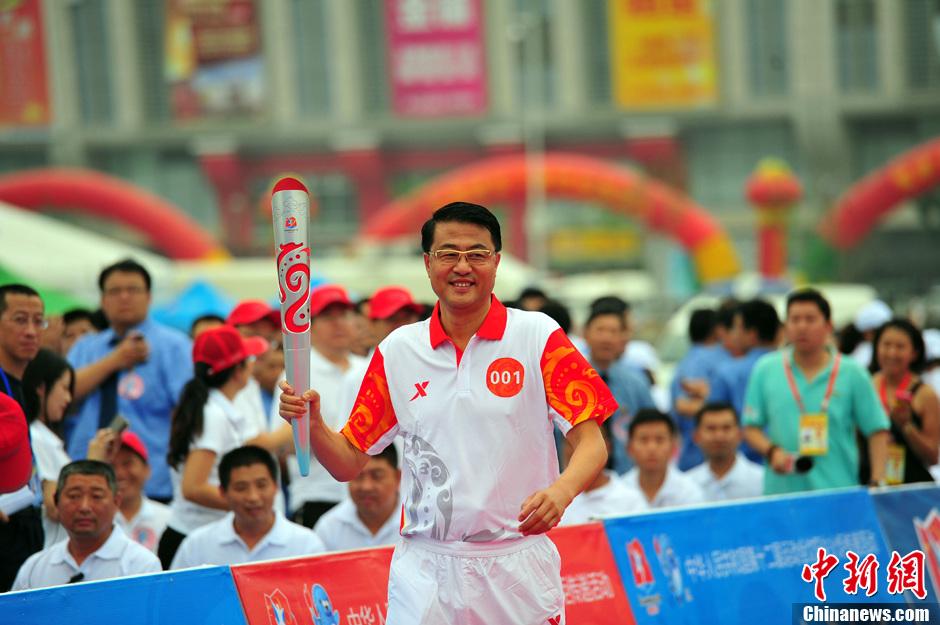 第十二届全运会火炬传递点火起跑仪式沈阳举行